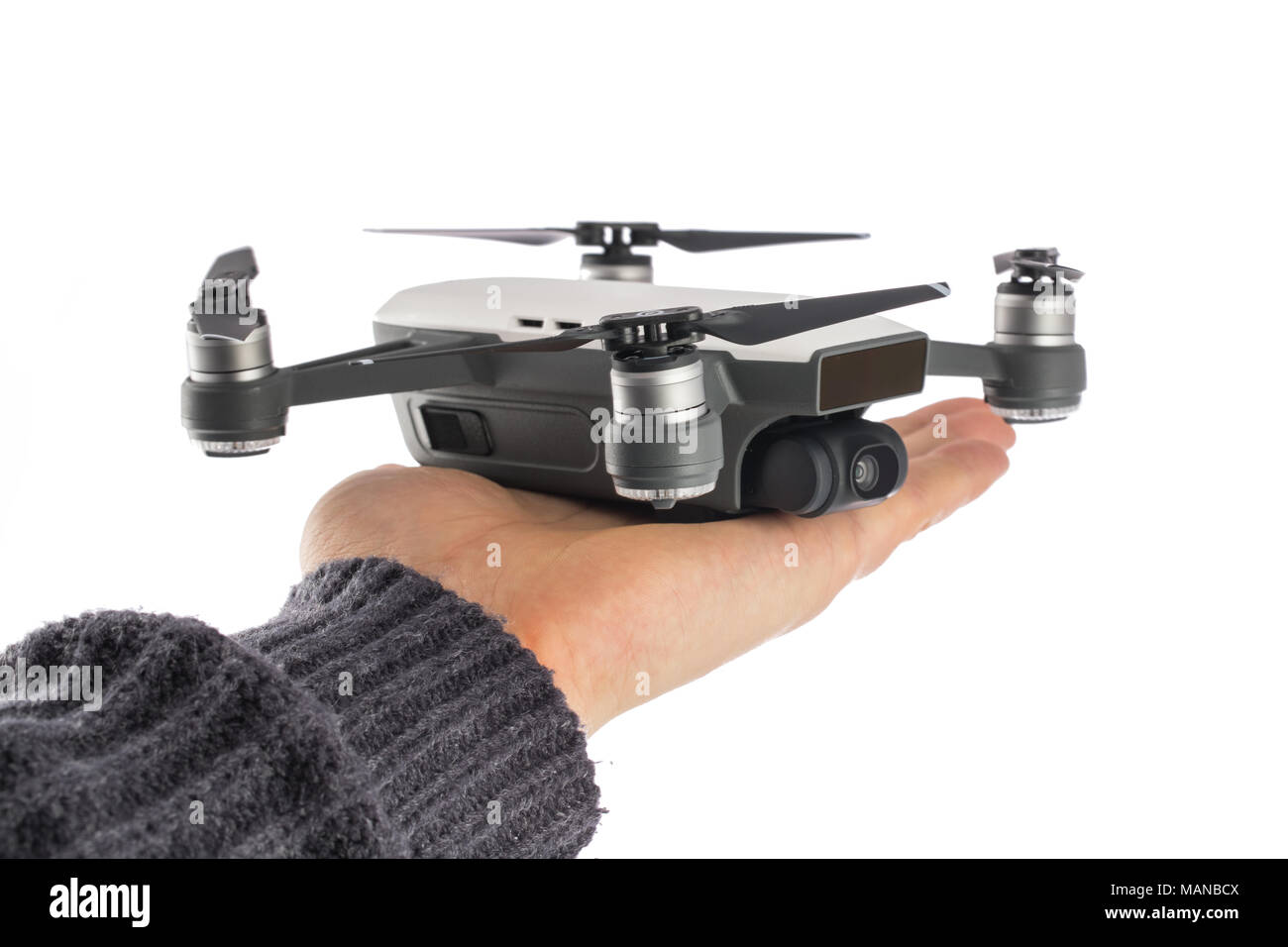 Varna, Bulgaria - February 14 ,2018: Flying drone quadcopter Dji Spark is mini drone that features all of DJI's signature technologies, isolated on wh - Stock Image