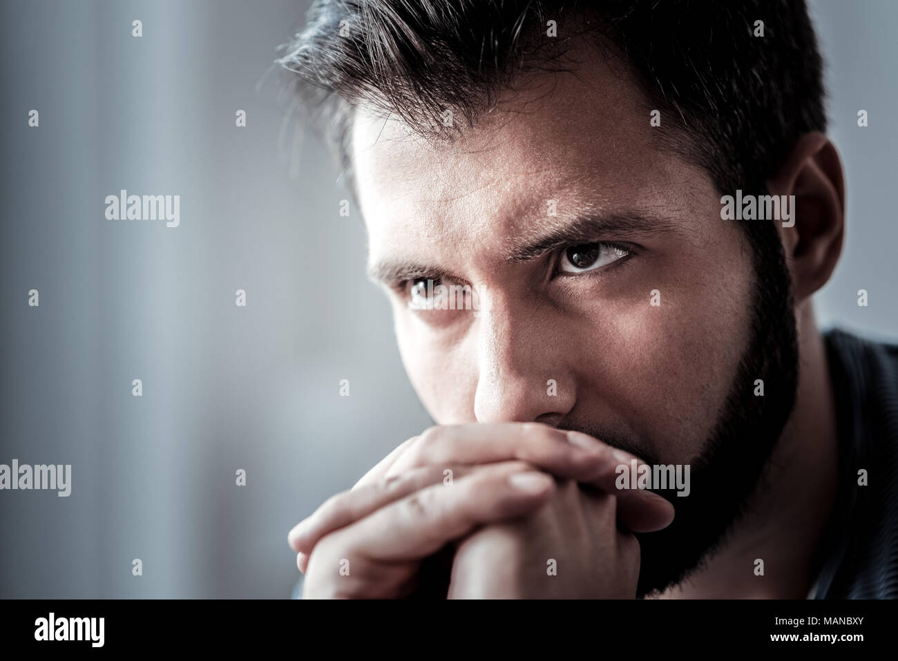 Portrait of an unhappy young man - Stock Image