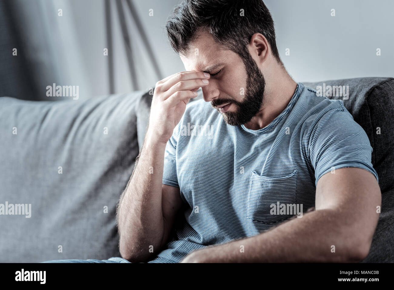 Sad unhappy man feeling tired - Stock Image