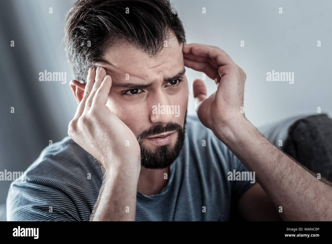 Depressed unhappy man having a headache - Stock Image