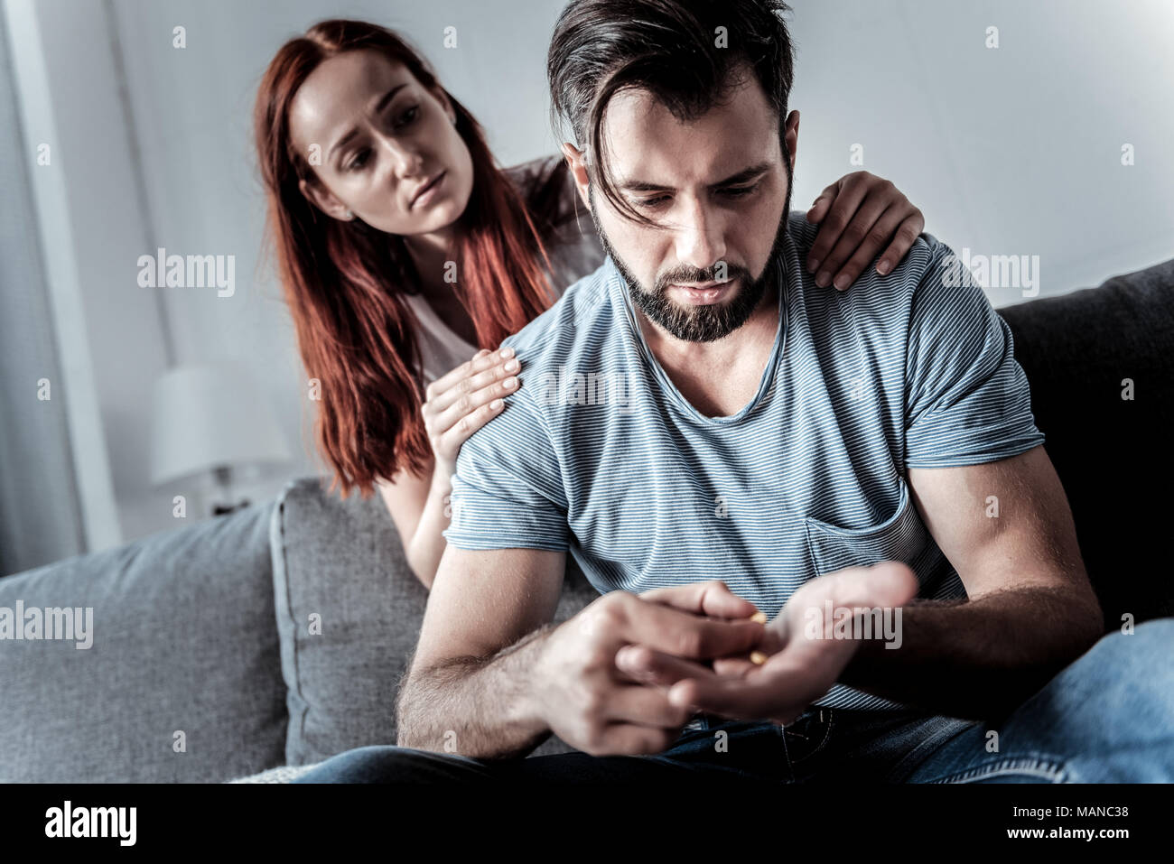 Nice young man suffering from depression - Stock Image
