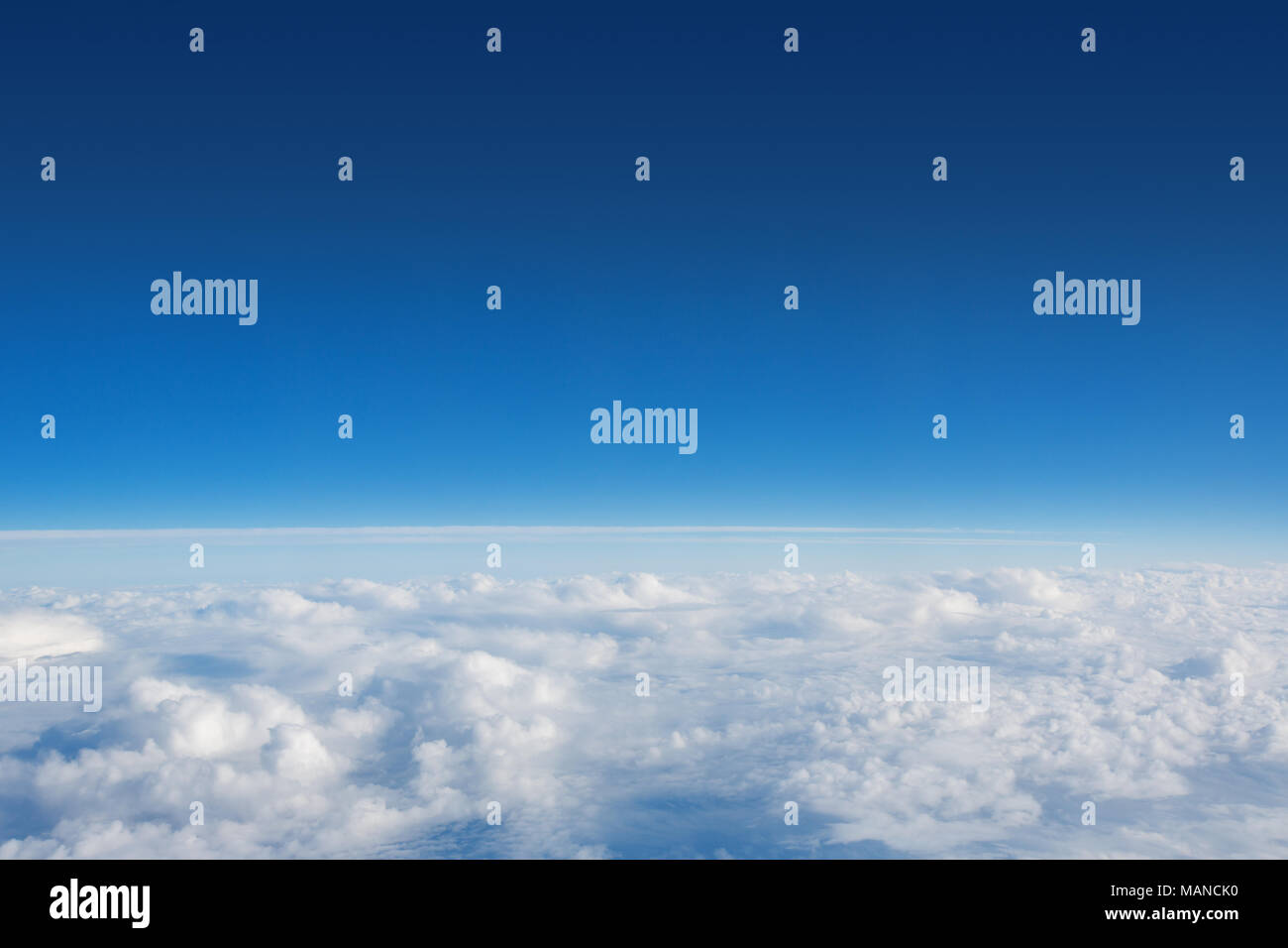 Above The Clouds Photo of puffy clouds - Stock Image