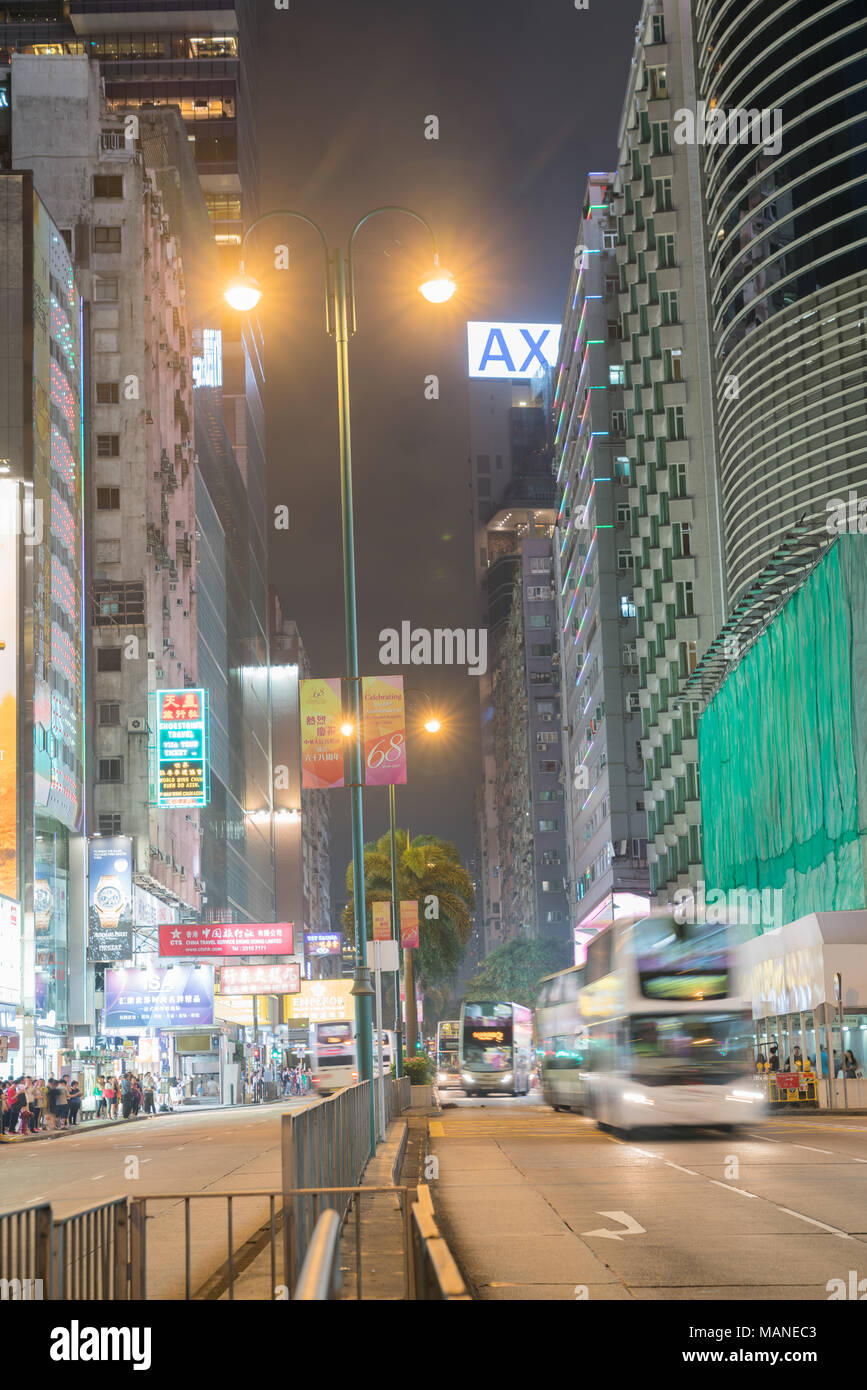 KOWLOON, HONG KONG - SEPTEMBER 19 2017; Typically Asian city street with 68th Chinese Republic Anniversary banners under night lights looking up Natha - Stock Image