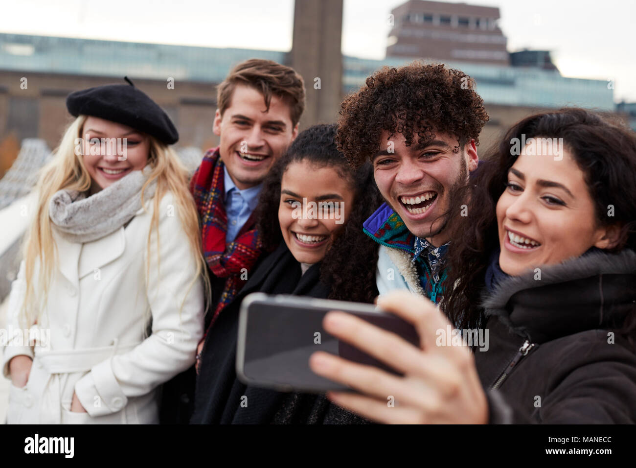 Group Of Young Friends Taking Selfie On Winter Visit To London - Stock Image