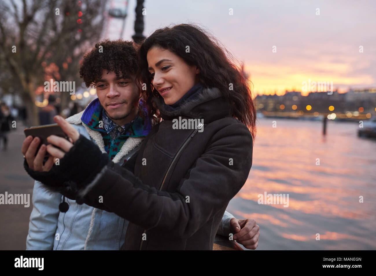Couple Taking Selfie During Walk Along South Bank In London - Stock Image