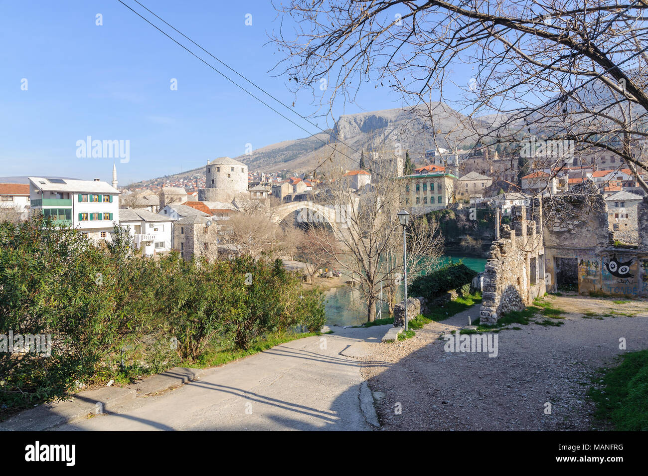 MOSTAR, BOSNIA - JAN 26, 2018: Stari Most (Old Bridge) is a rebuilt 16th-century Ottoman bridge in the city of Mostar in Bosnia that crosses the river Neretva and connects the two parts of the city. - Stock Image