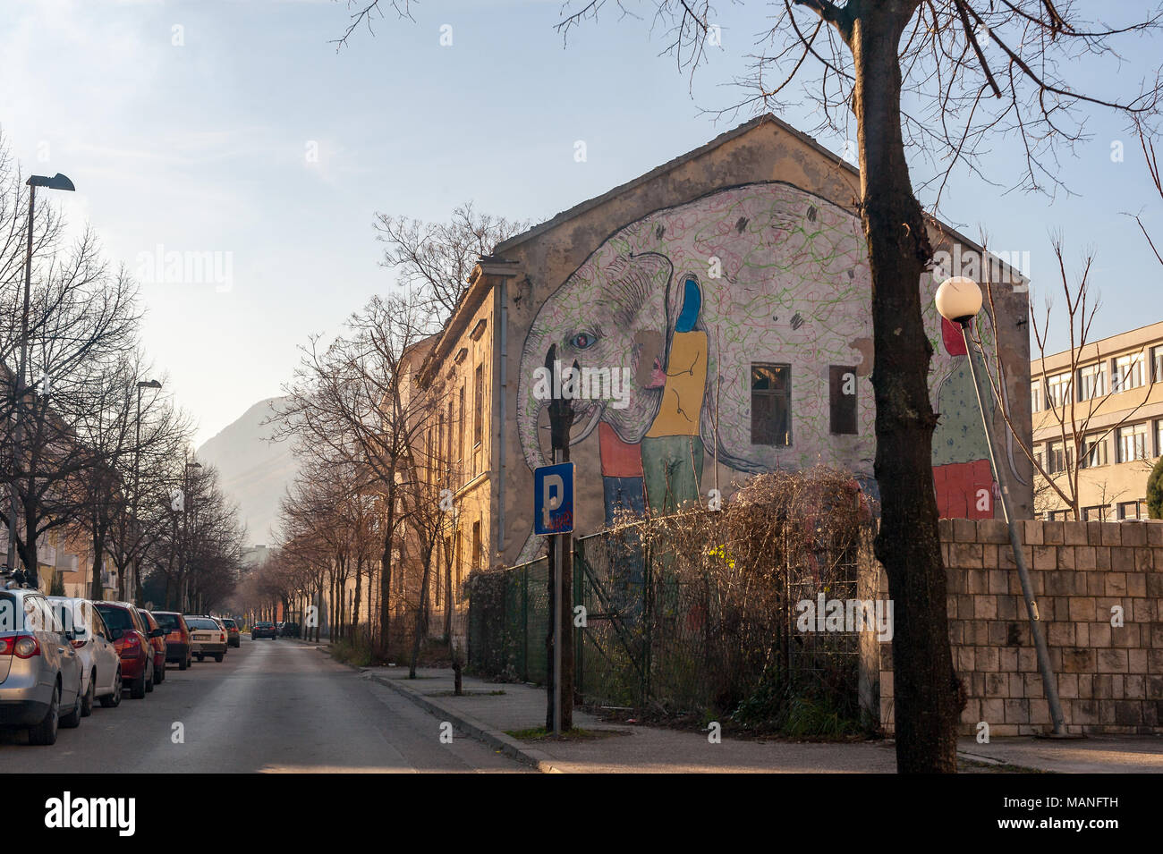 MOSTAR, BOSNIA - JAN 26, 2018: Street with mural painting in the Old Town, Mostar in Bosnia-herzegovina. The name Mostar itself means bridge-keeper - Stock Image