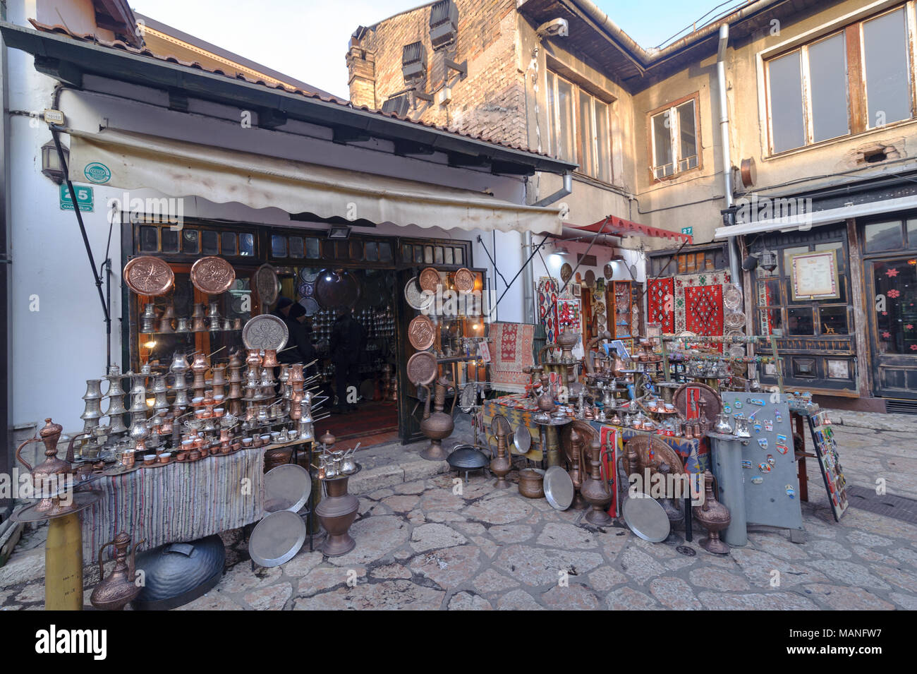 SARAJEVO, BOSNIA - JAN 26, 2018: Open Street touristic market in the old Town, Sarajevo in Bosnia-herzegovina. Old Style handmade copper products are very famous. - Stock Image