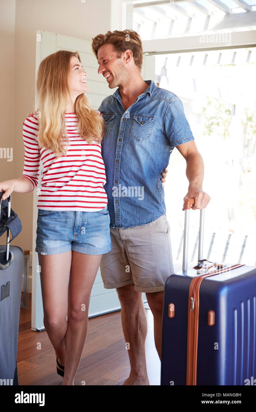 Couple Arriving At Summer Vacation Rental - Stock Image