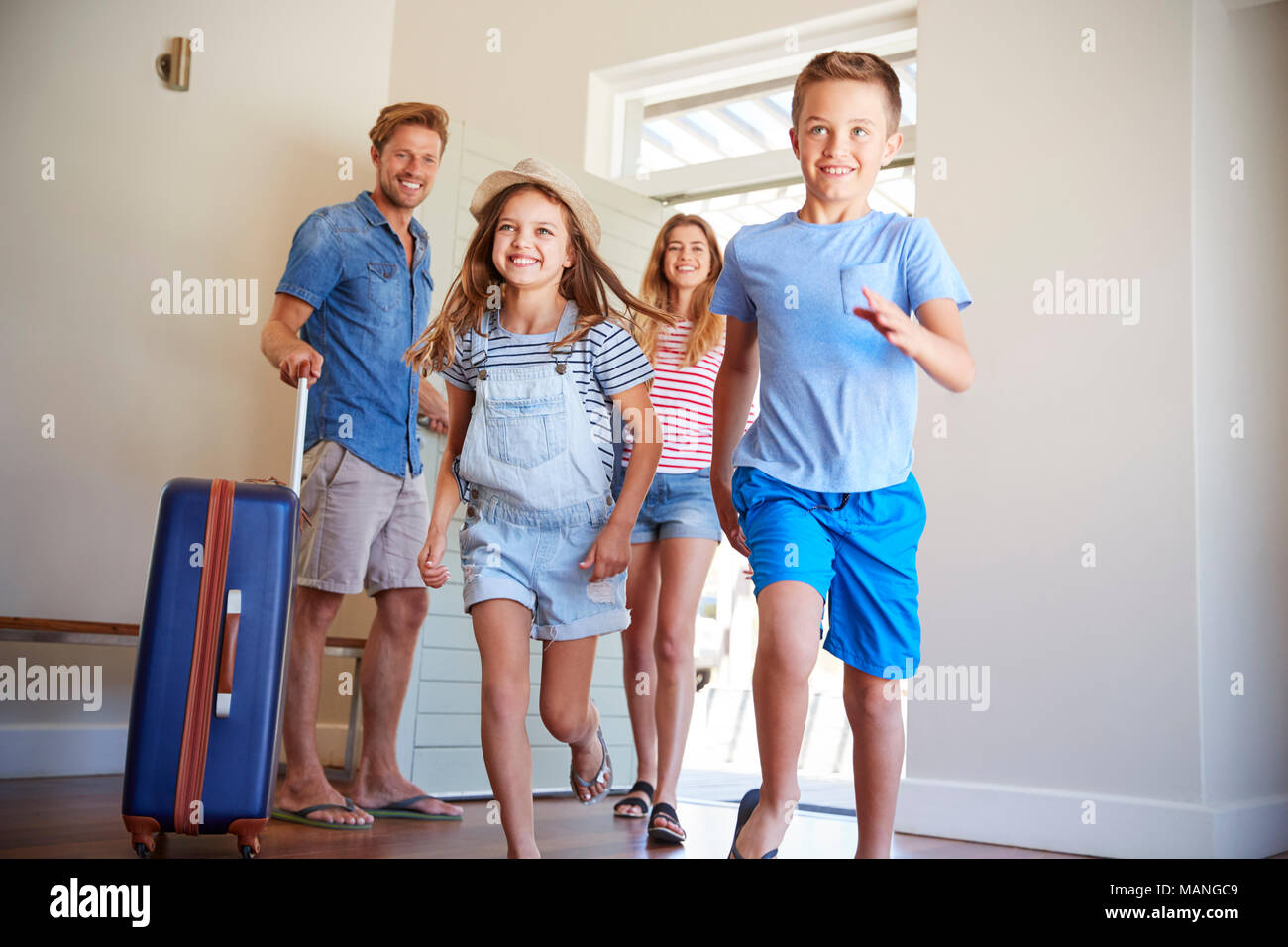 Family Arriving At Summer Vacation Rental Stock Photo