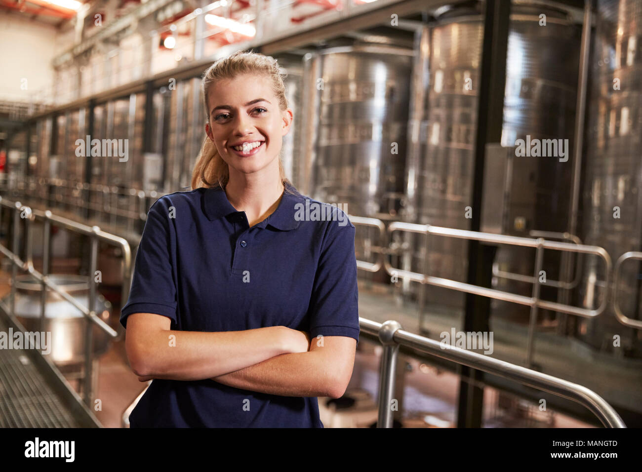 Portrait of a young white woman working at a wine factory Stock Photo