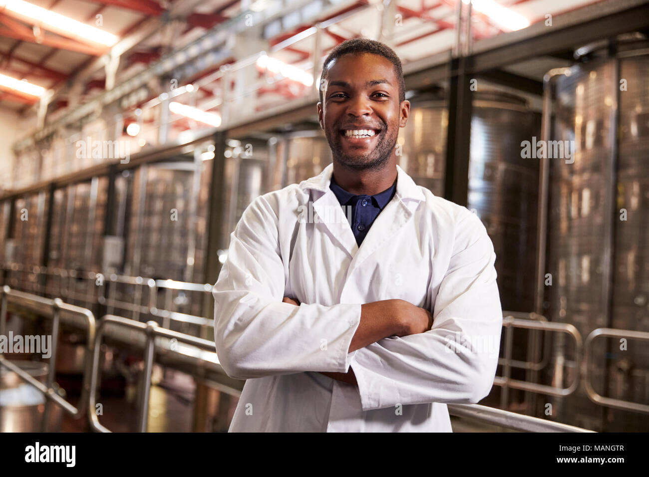 Young black male wine factory technician smiling to camera Stock Photo