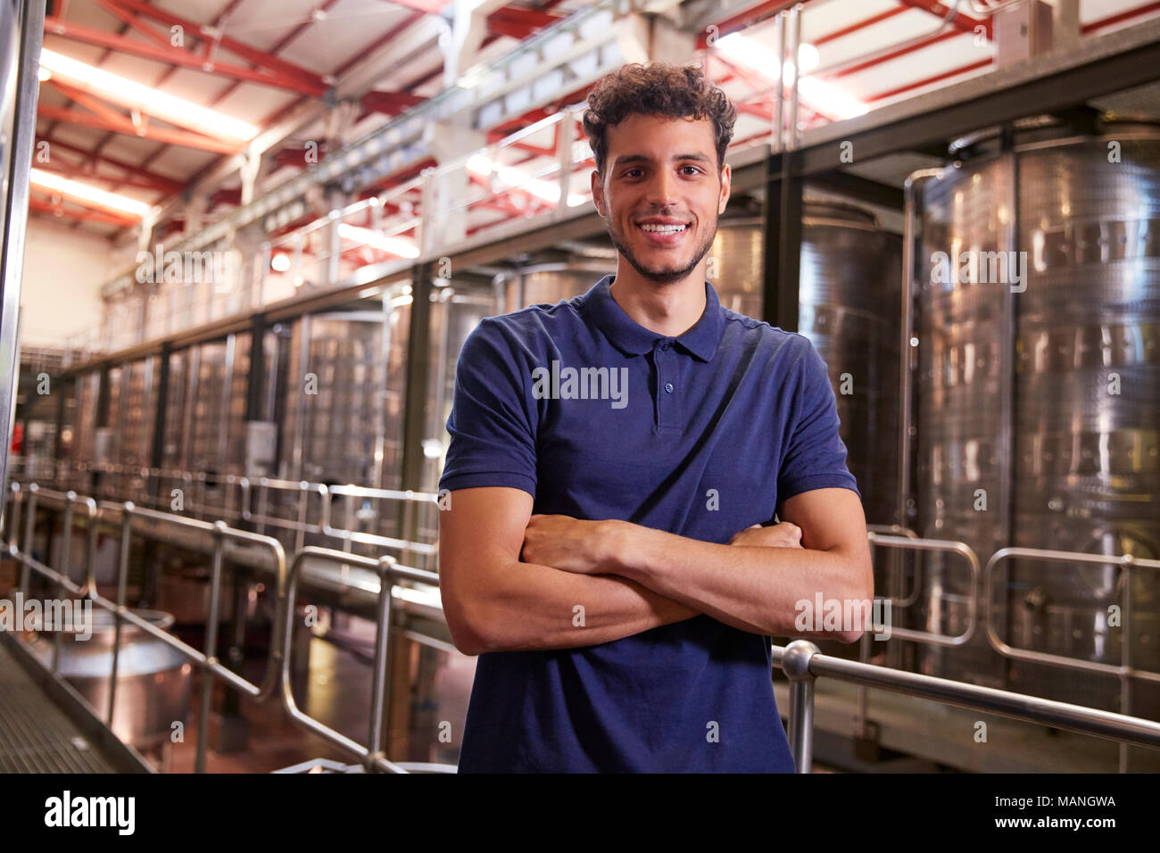 Portrait of a young Hispanic man working at a wine factory Stock Photo