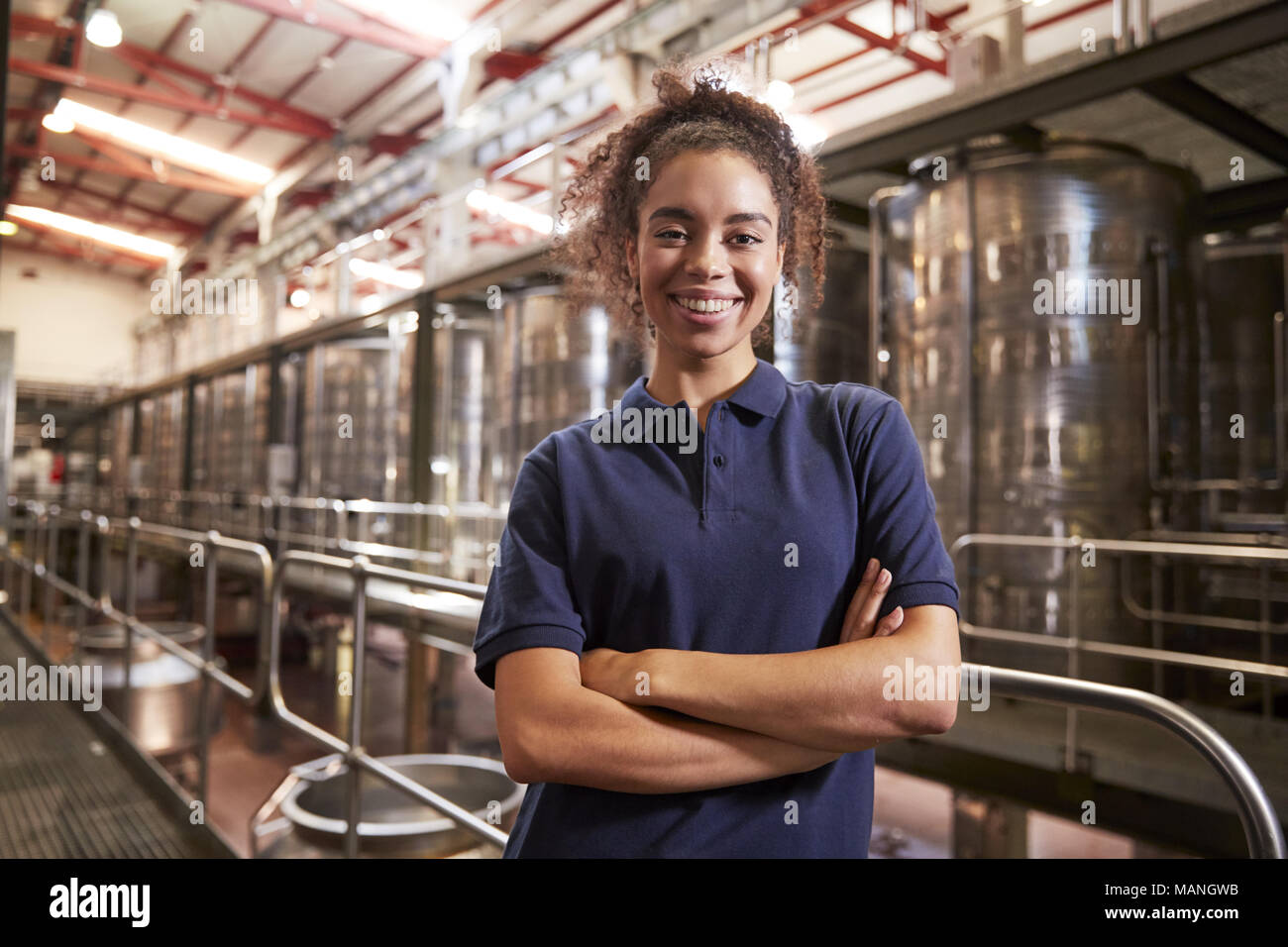 Portrait of young mixed race woman working at a wine factory Stock Photo