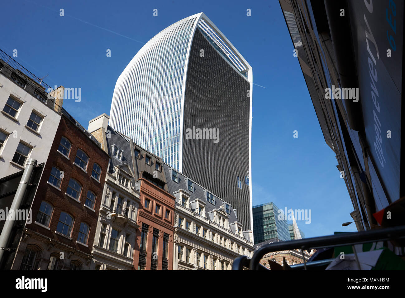 LONDON - MAY, 2017: The Walkie Talkie building, 20 Fenchurch Street, looming over a Victorian terrace, City Of London, London Stock Photo