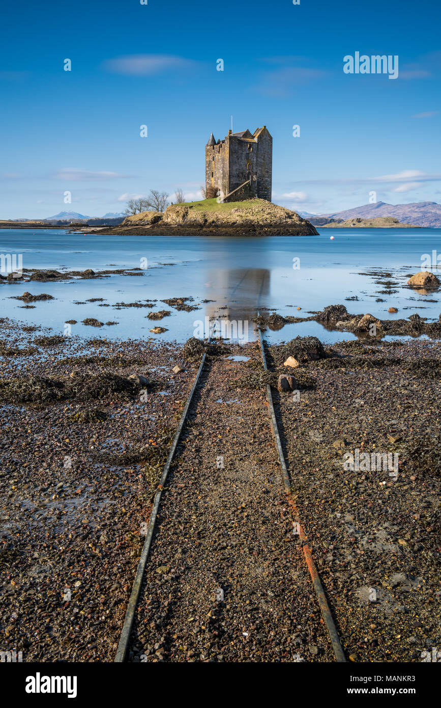 Castle Stalker is a medieval tower house standing on a small rocky islet in the mouth of Loch Laich. It is located about 2.4 km north east of Port App - Stock Image