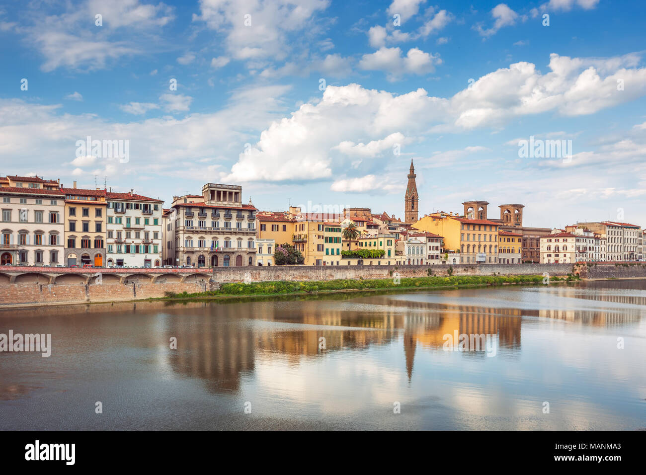 View of Ponte Vecchio with reflections in Arno River, Florence, Italy - Stock Image