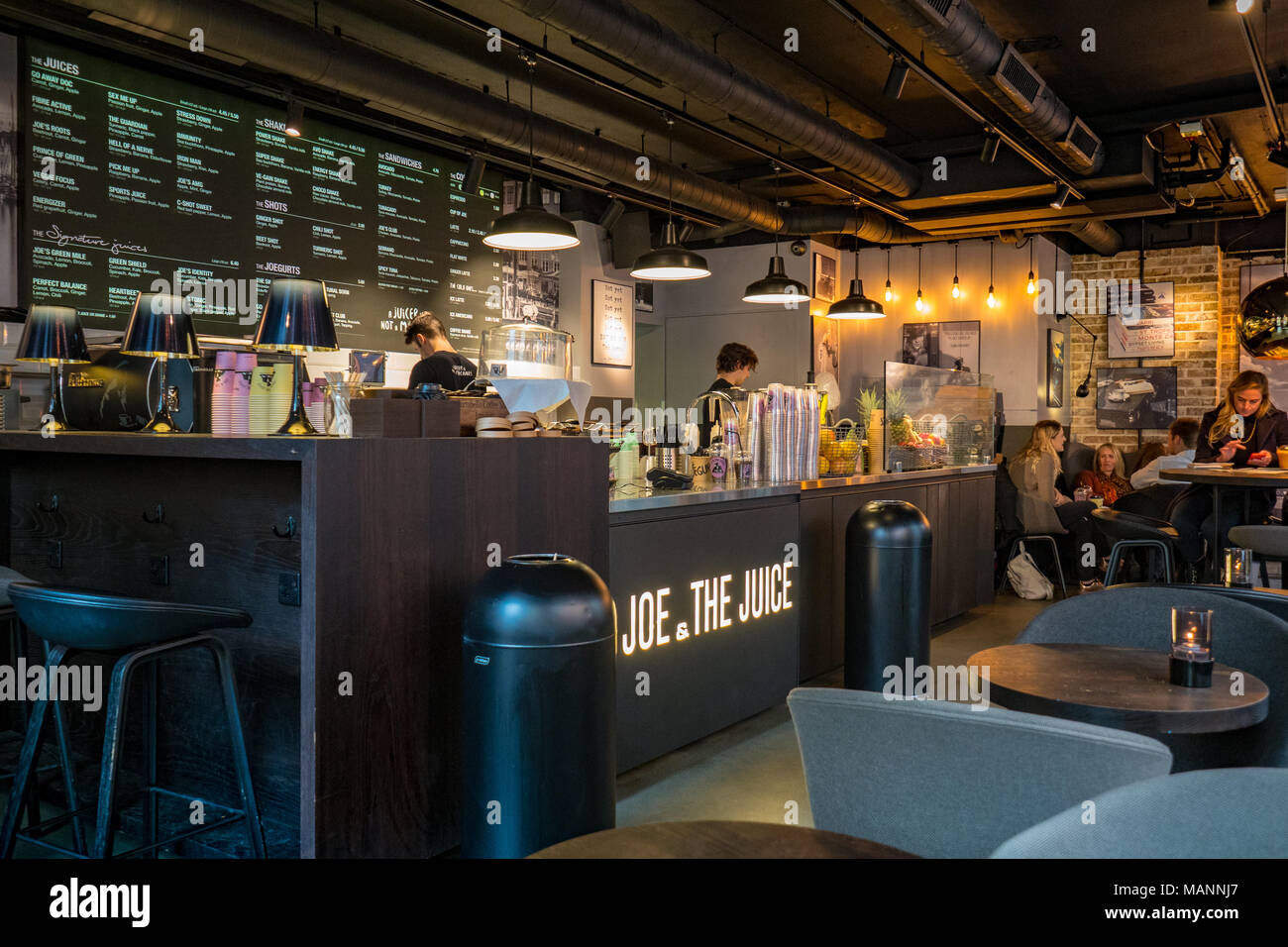 Joe and the Juice Cafe Restaurant in the City of London, London's financial district. Joe and the Juice is a chain originally set up in Denmark. - Stock Image