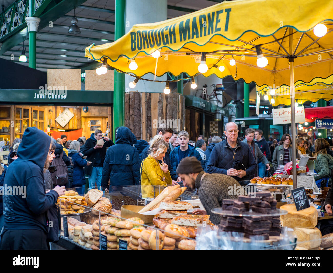 Borough Market selling speciality foods in central London, one of London's largest food markets, located at the southern end of London Bridge. - Stock Image