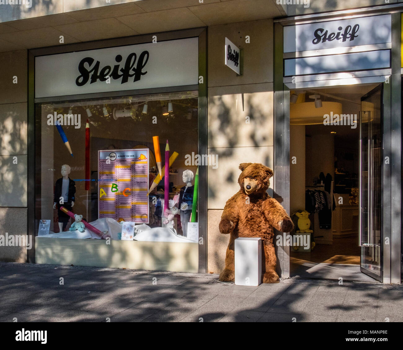 Berlin, Charlottenburg. Steiff teddy bear shop in Kurfürstendamm.Hand-made collectible toys with numbered certificate attached to ear - Stock Image