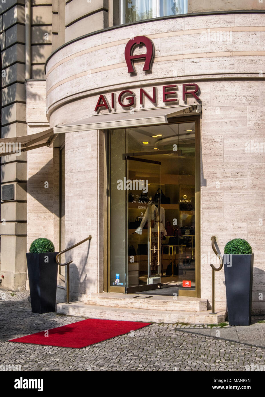 Berlin, Charlottenburg. Aignor store selling high-end leather goods, bags & acceesories on Kurfürstendamm shopping street - Stock Image