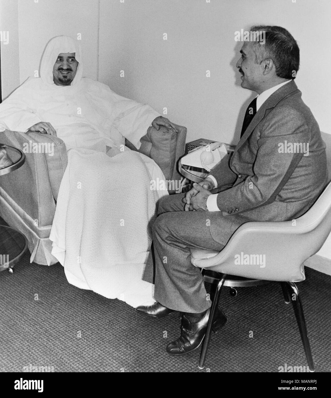 24th February 1977. London. King Hussein of Jordan visits King Khaled of Saudi Arabia at the London Hospital where the King is recovering from a hip operation. the 64 year old Saudi Arabian King received Hussein in his suite at the Wellington Hospital in St. John's Wood. - Stock Image