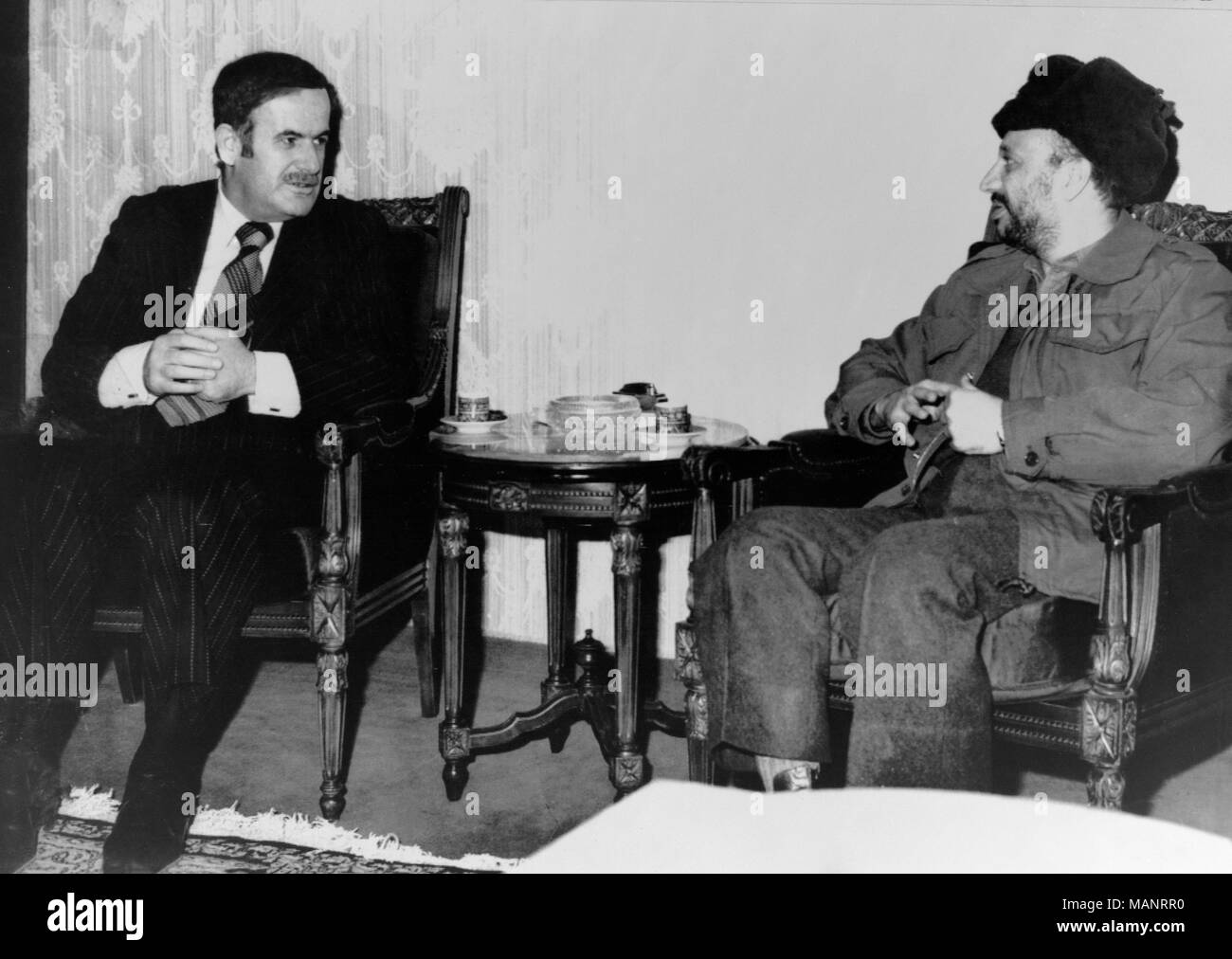 5th February 1977. Damascus. Syrian President Assad talks with PLO leader Yasser Arafat. - Stock Image