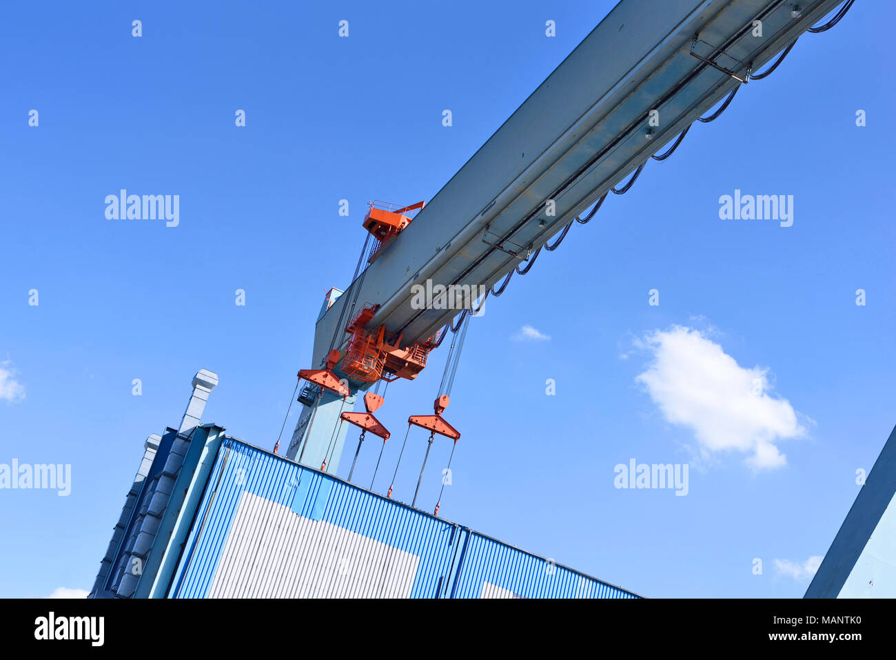 Container harbor with harbor cranes or freight cranes. Warf or cargo shipping scene, industrial transportation or shipping scene. Hamburg harbor. - Stock Image