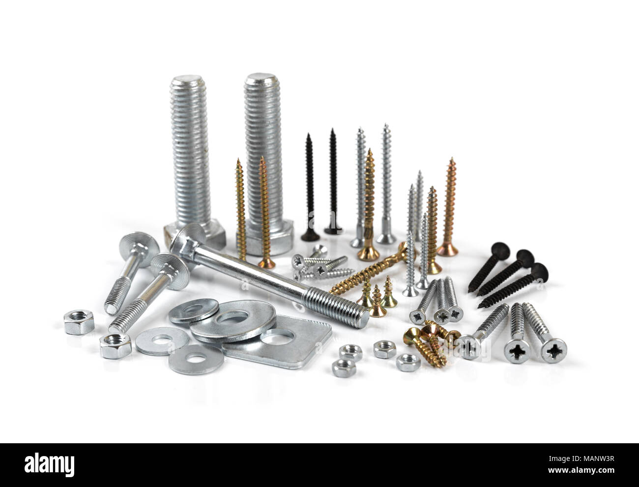 variety of screws and fasteners isolated on white background - Stock Image