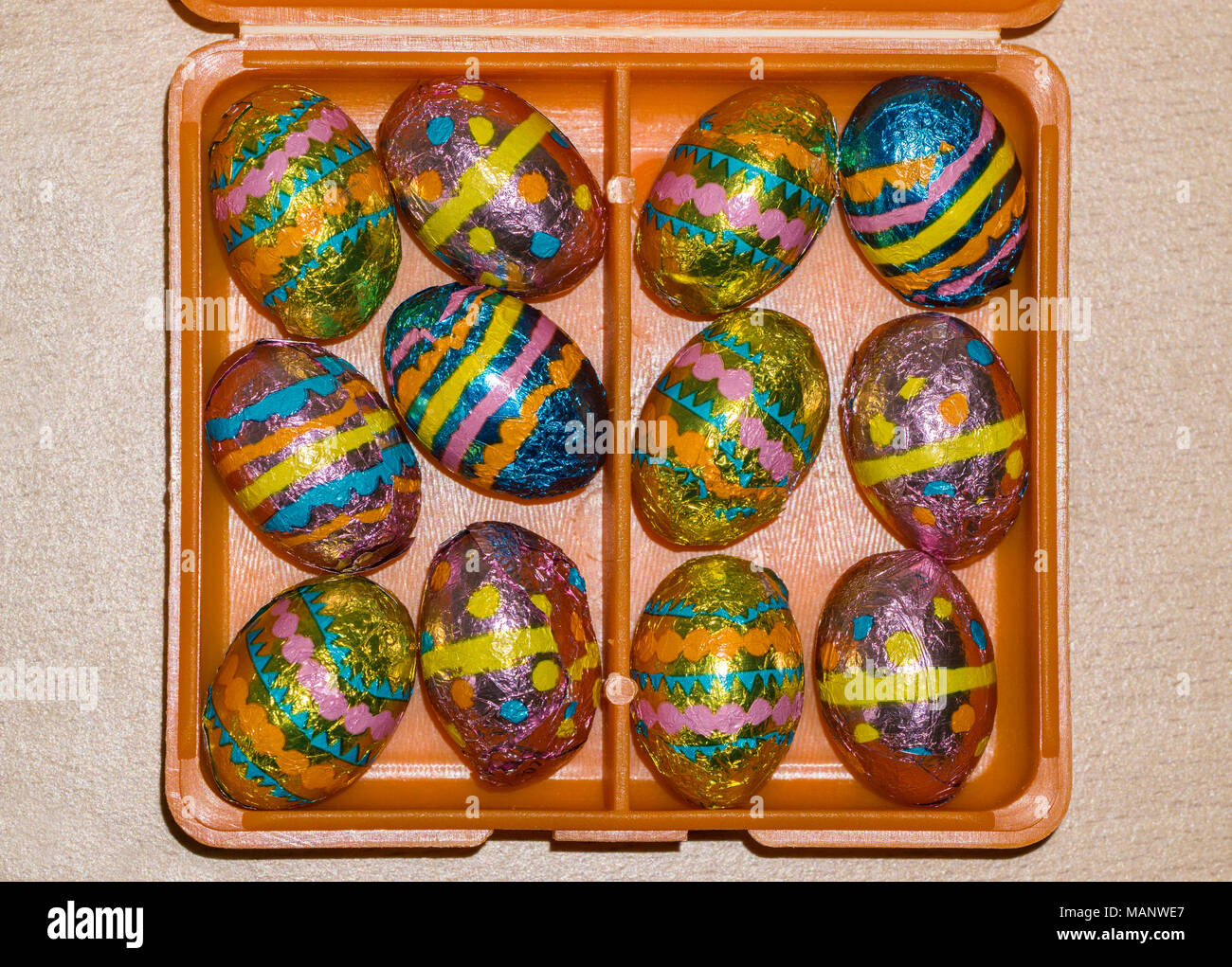 foil wrapped mini chocolate easter eggs in box - Stock Image