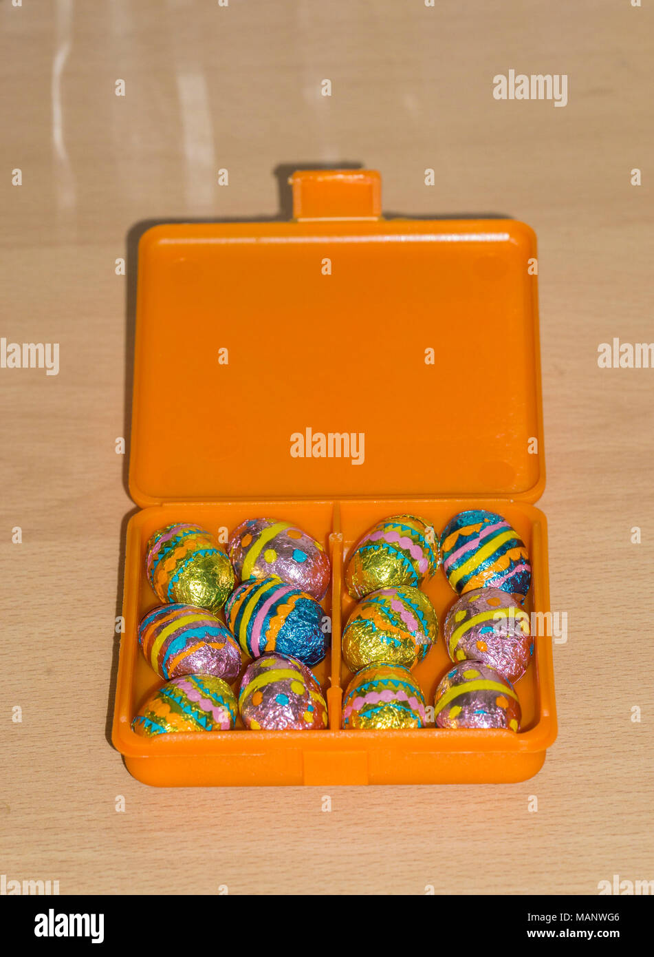 foil wrapped mini chocolate easter eggs in box Stock Photo