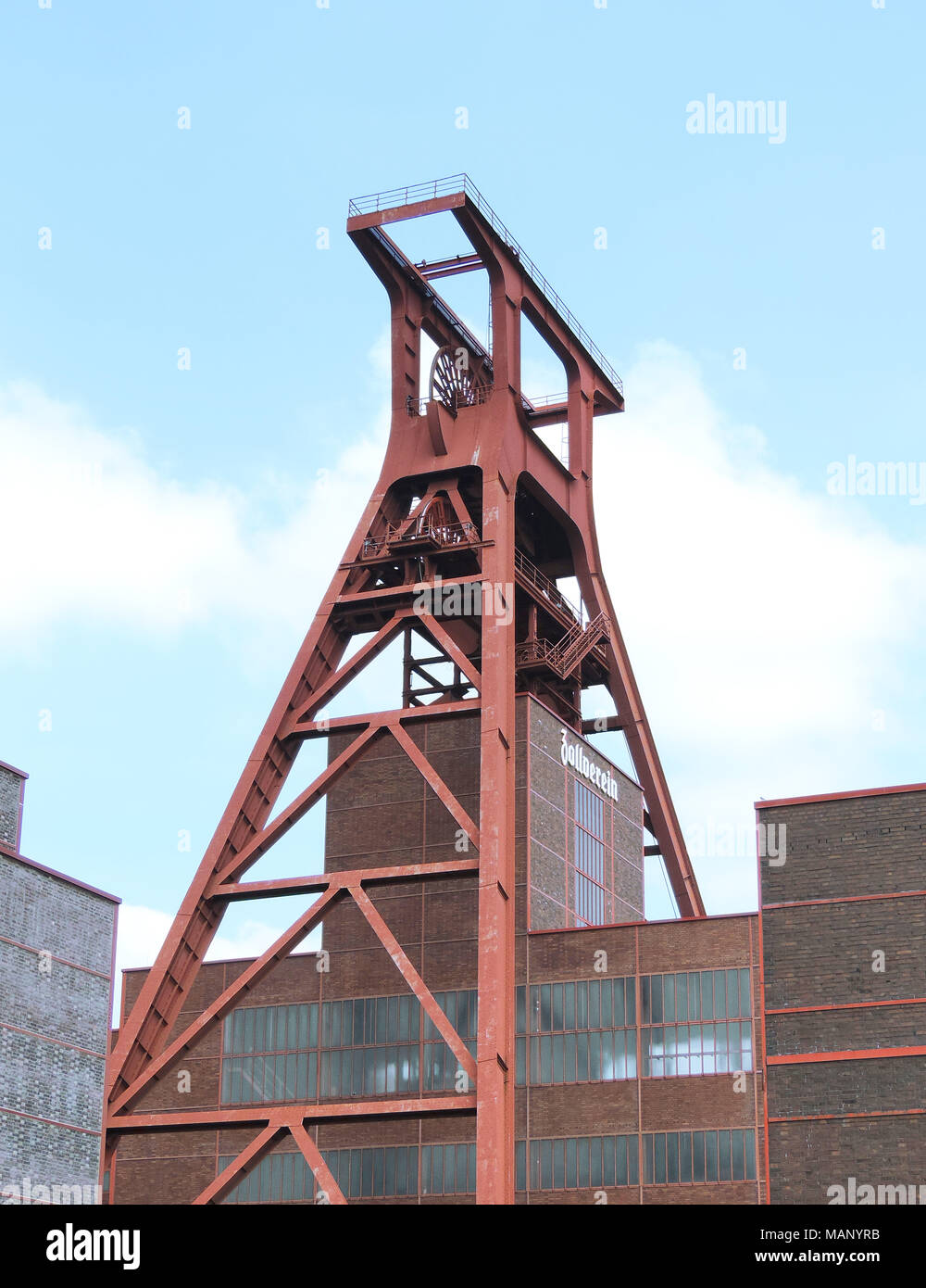 Zeche Zollverein, unesco heritage in Essen, Ruhrgebiet. Famous place, old coal mine shaft and blue sky. - Stock Image