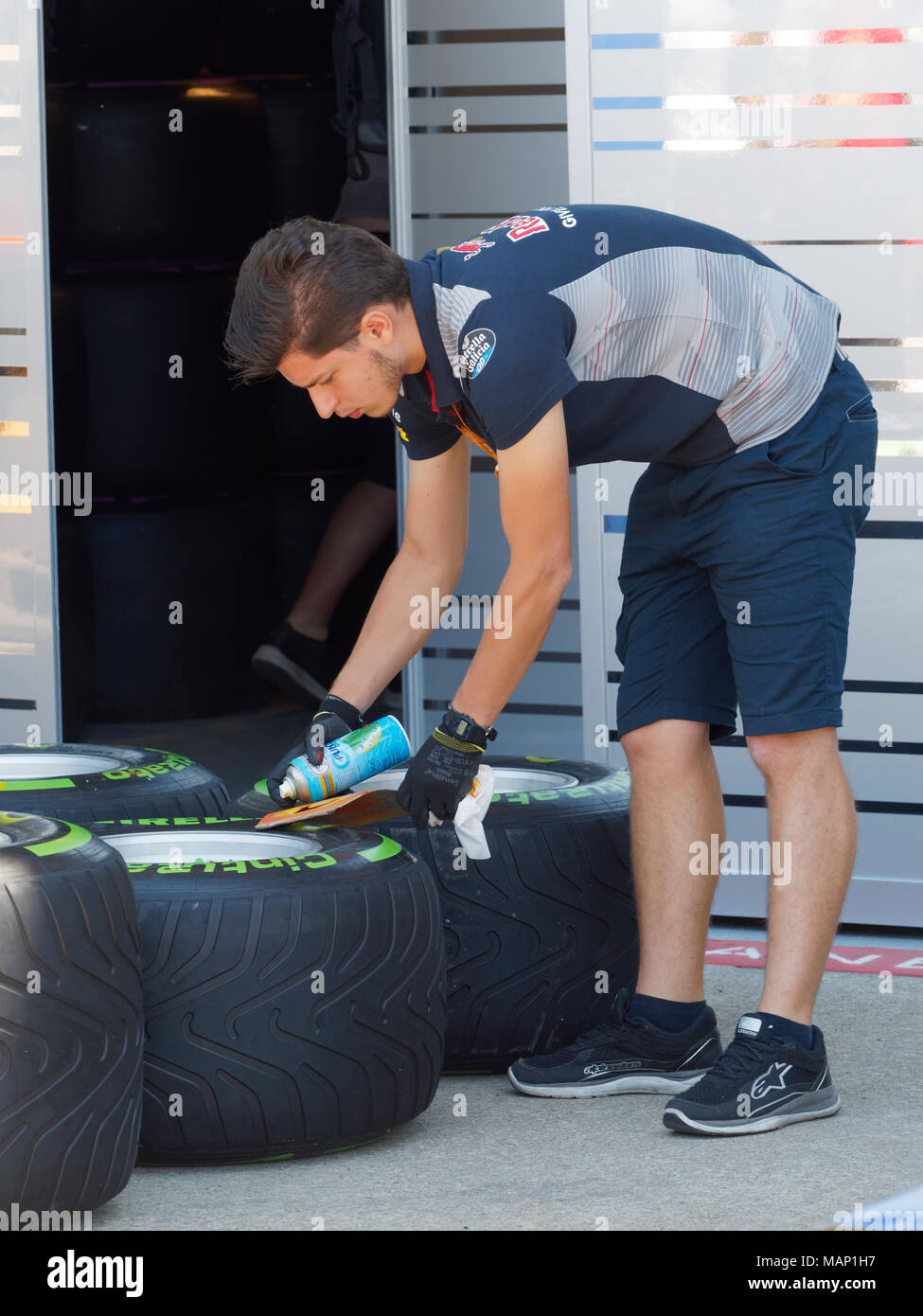 Montreal, Quebec.A mechanic for Scuderia Toro Rosso is marking tires to be used in the Canadian Grand Prix in Montreal,Quebec - Stock Image