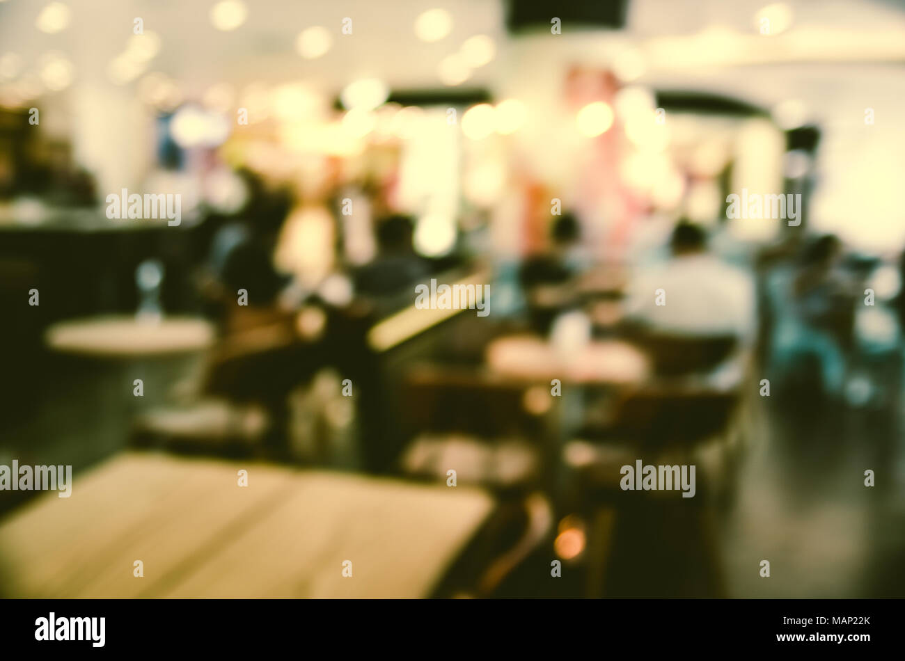 Blurred background made with Vintage Tones,Coffee shop blur background with bokeh and working man in cafe - Stock Image