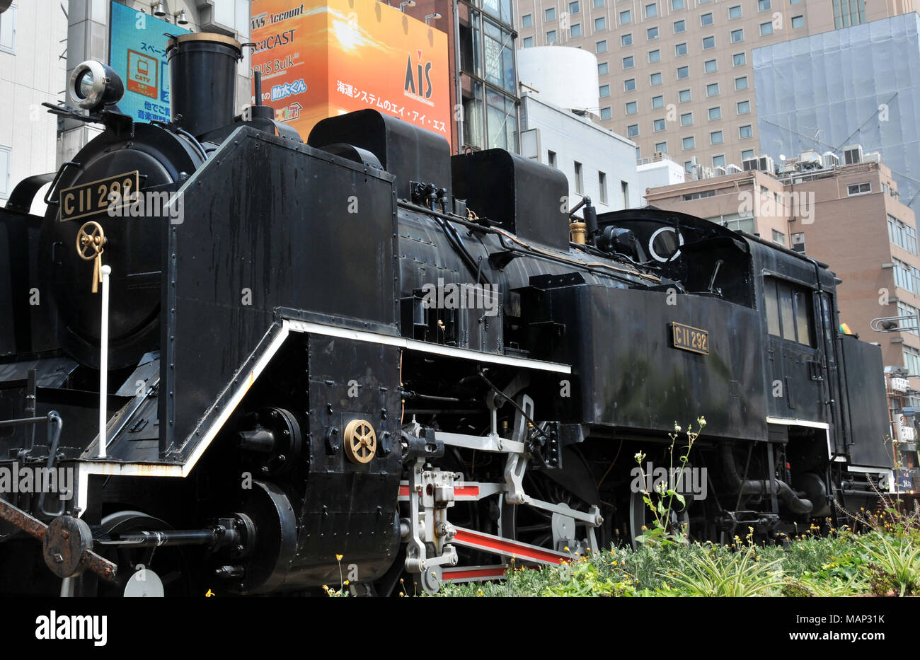 old steam locomotive in front of Shimbashi Station in Minato-Ku, Tokyo, Japan Stock Photo