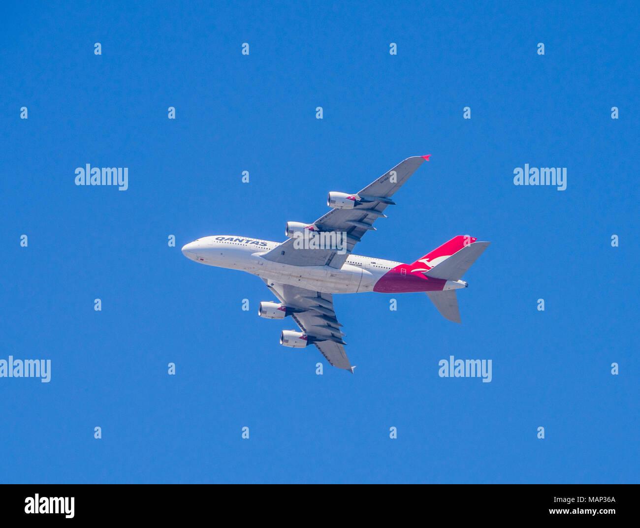 Quantas Airbus A 380 in flight over Sydney Harbour - Stock Image