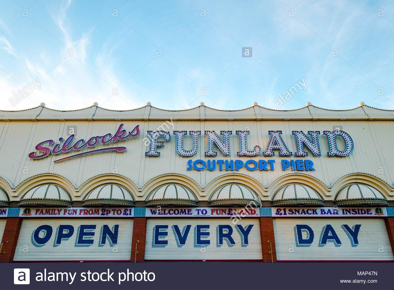 Slicocks Funland on Southport Pier the family run amusement arcade which is open every day, photo of the exterior showing it closed, close to 6 pm Stock Photo