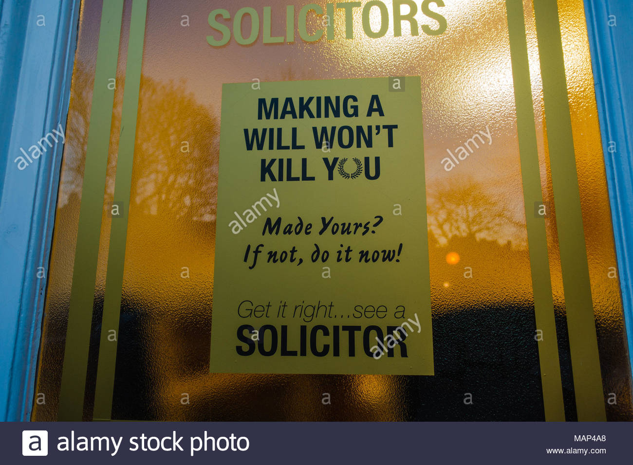 "Solicitors frosted glass window etched with a statement, stating ""making a will won't kill you"" & ""made yours? If not do it now!"" ""Get it Right See a  Stock Photo"