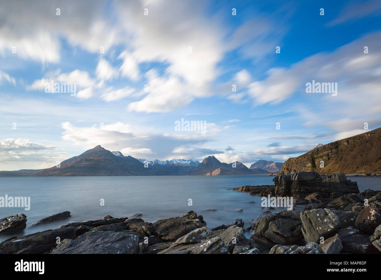 Elgol Beach and Black Cuillin hills on Isle of Skye, Scotland, UK in March - long exposure - Stock Image