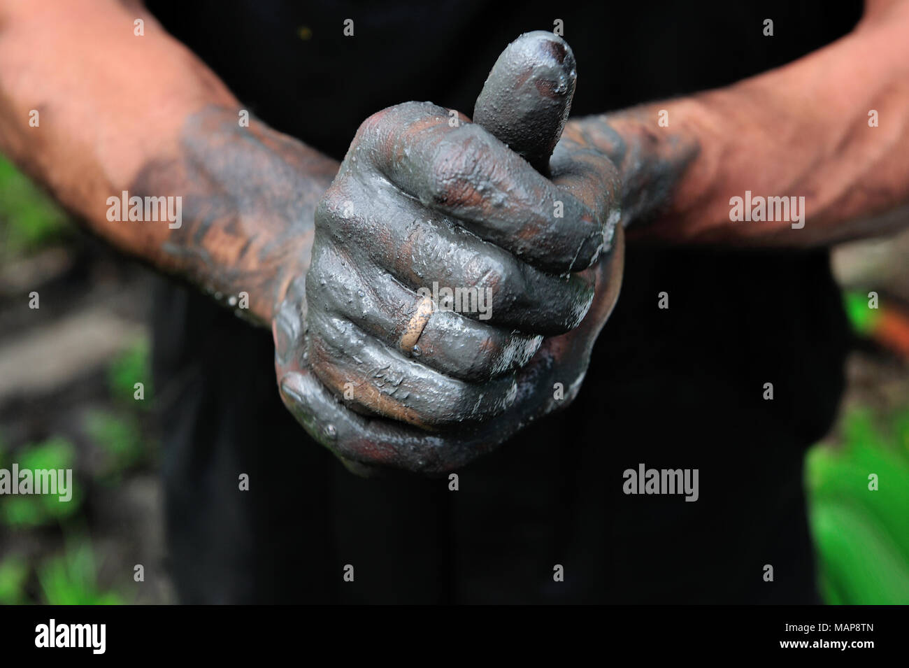 a person, a working, arm, black works, craftemployment, illegally employment, illicit workprofessional life, professionally, hard, danger, work - Stock Image