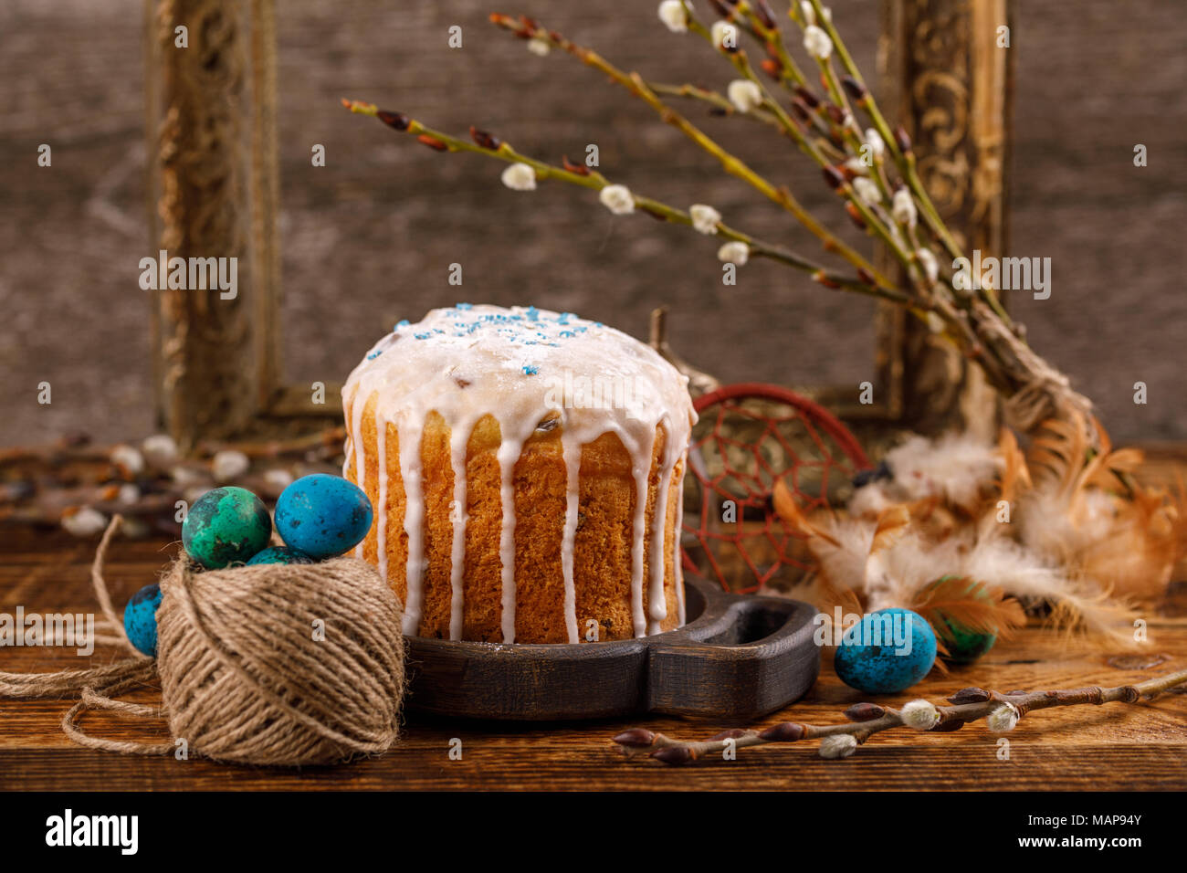 Christian holidays photos of Easter food in a rustic style. The table is covered with Easter cakes and painted eggs. Family Orthodox holiday - Stock Image