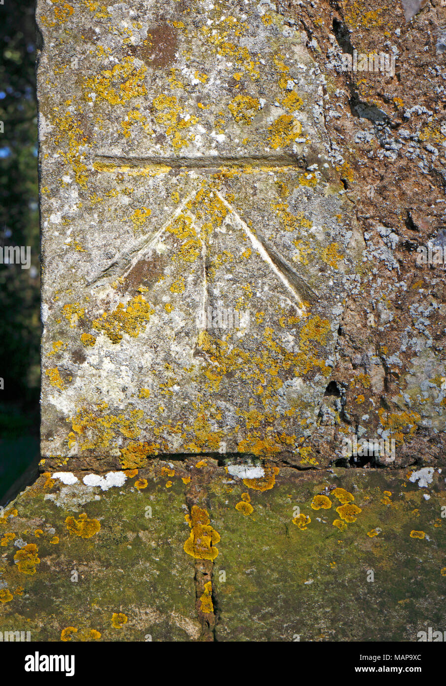 An example of an Ordnance Survey Bench Mark on the corner of the Church tower of St Michael at Irstead, Norfolk, England, United Kingdom, Europe. - Stock Image