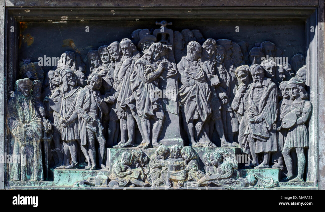 Bas relief depicting the benefits of printing in Europe, pedestal of Gutenberg monument, Place Gutenberg square, Strasbourg, Alsace, France, Europe, - Stock Image