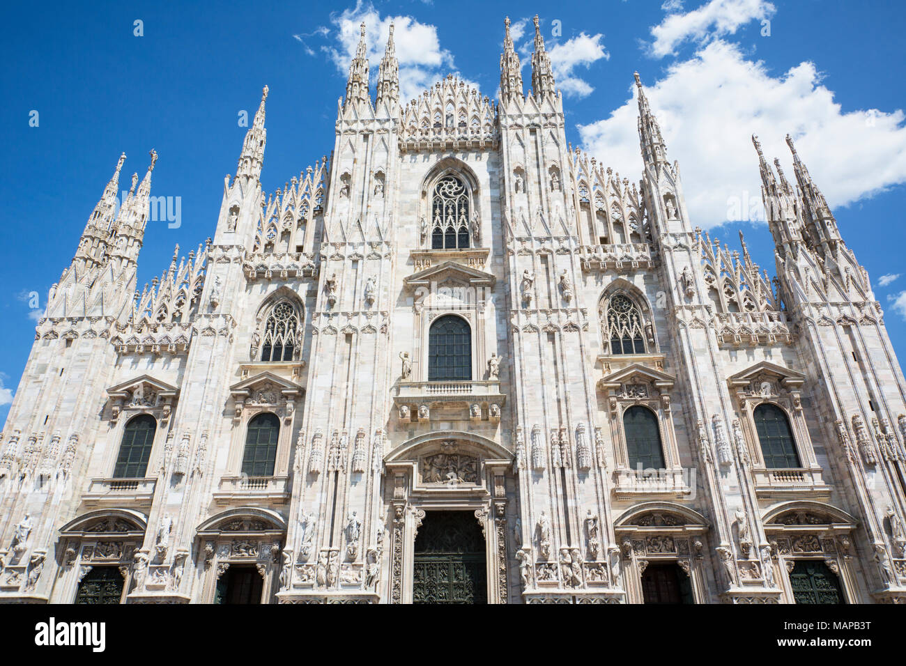 Milan, Milan Province, Lombardy, Italy.  Facade of the Duomo, or cathedral, in the Piazza del Duomo. - Stock Image