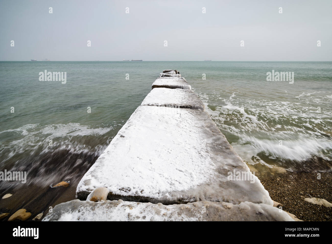 Concrete pier with ice and snow in Varna, Bulgaria Stock Photo