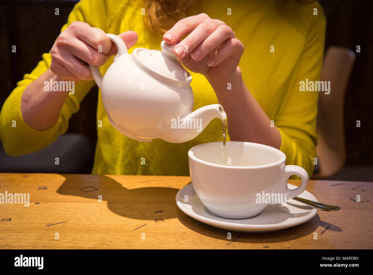 Hand Holding A Teapot Pouring Tea In A White Cup Stock Photo Alamy Hd wallpaper tea cup kettle hands