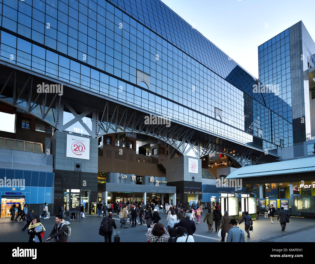 Kyoto Station, Kyoto-eki, modern glass building busy with people in the evening, second largest train station building in Japan. Shimogyo-ku, Kyoto, J Stock Photo