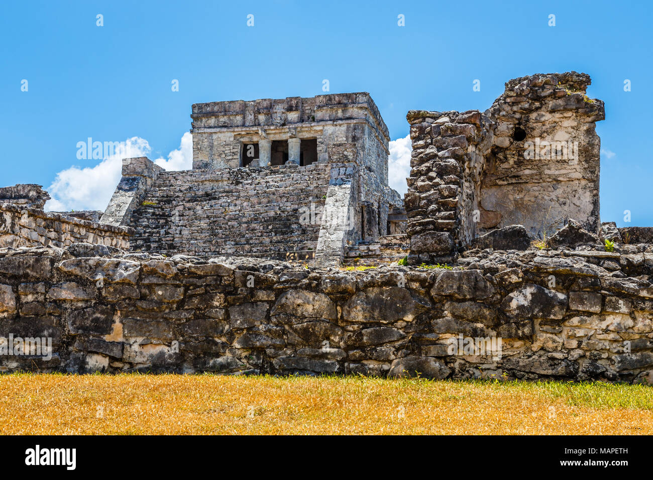 Old ruined ancient Mayan temple with blue sky, Tulum ... on map mexico tulum quintana roo, map of yaxchilan, map of mexico, map of isla mujeres, map of tikal, map of soliman bay, map of chetumal bay, map of playa del carmen, map of cozumel, map of mérida, map of troncones, map of naranjo, map of patzcuaro, map of xilitla, map of yucatan, map of xcaret, map of cancún, map of punta allen, map of michoacán, map of chichen itza,