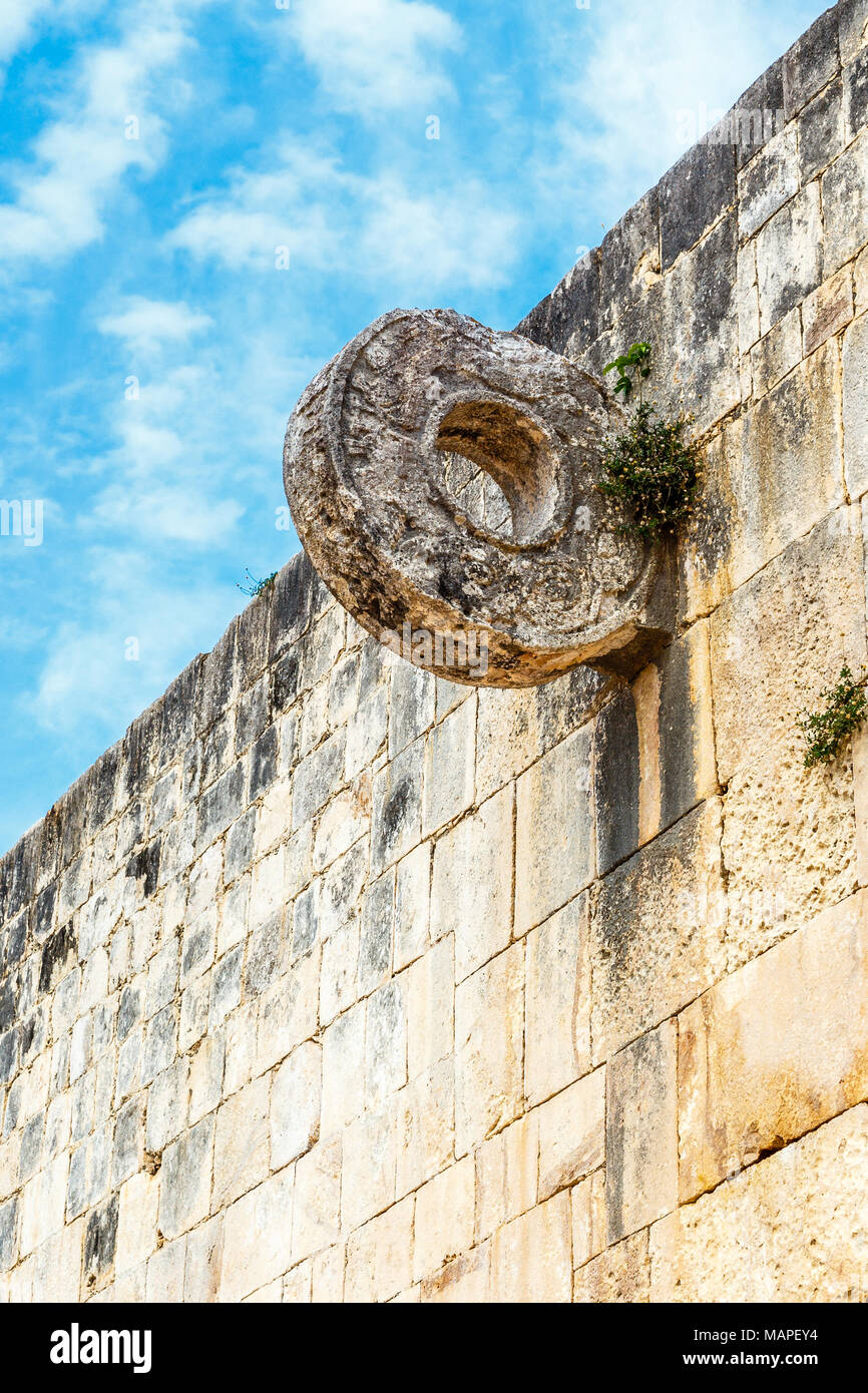 Mayan football game ring on the stone wall, Chichen Itza archaeological site, Yucatan, Mexico - Stock Image