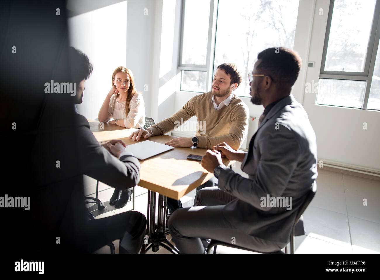 Business people listening to marketing professional african speaker presentation - Stock Image